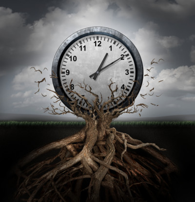Time planning and efficiency management business concept as a clock breaking free from a tree trunk as a surreal symbol for productivity schedule and strategy.